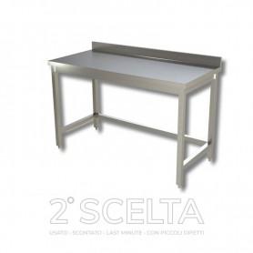 Tavolo inox senza ripiano di fondo, con alzatina posteriore. Dim.cm. 90x70x85h *piccoli danneggiamenti*